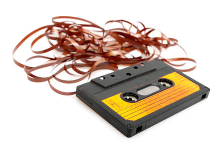 cassette tape: Retro Audio Cassette Tape With Pulled Out Tape on White Background - Shallow Depth of Field