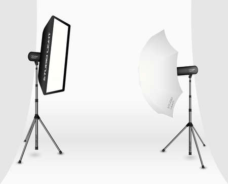 reflectors: Photographic LIghting - Two Professional Studio Lights with Soft Box and Umbrella on Tripods on White Background