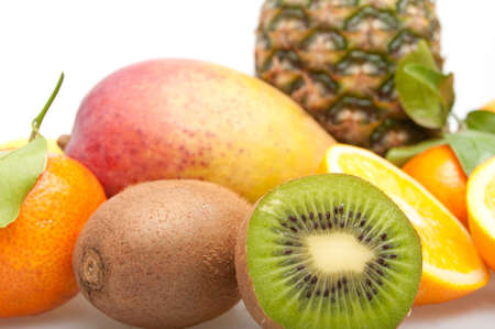 Tropical Fruits - Pineapple, Oranges, Kiwi, Mango and Tangerine on White Background Stock Photo - 11320867