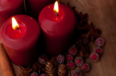 Burning Red Christmas Candles With Decorations on Old Wooden Table Stock Photo - 11320864