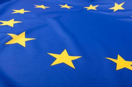 Closeup of Glossy Flag of European Union - EU Flag Drapery photo