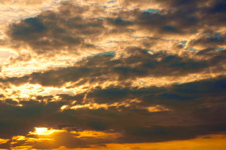 Colorful dramatic sky with Clouds at Sunset photo