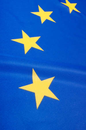 Closeup of Glossy Flag of European Union - EU Flag Drapery photo