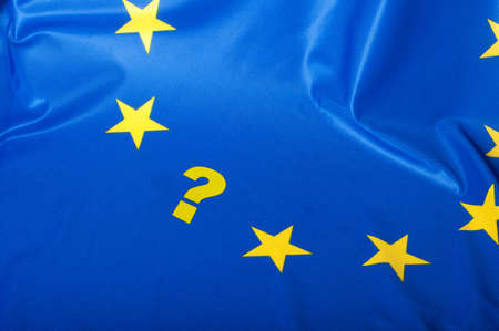 Euroscepticism - Detail of Silky Flag of Blue European Union EU Flag Drapery With Question Mark photo