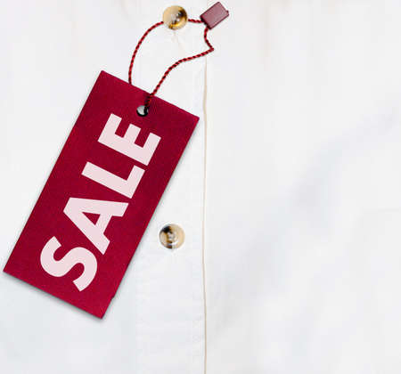 Red Sale Sign on White Shirt - With Copyspace photo