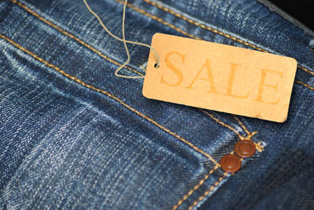 Red Sale Sign With Jeans in Background photo