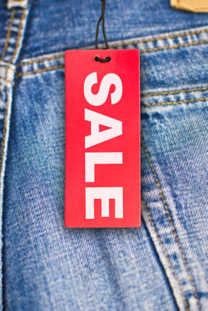 Red Sale Sign With Jeans in Background Stock Photo - 11799666