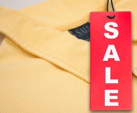 Hanging Red Sale Tag and Yellow Polo Shirt Stock Photo - 11799692