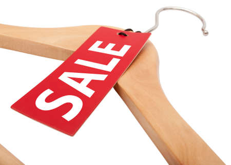sellout: Red Tag With Sale Sign Hanging on Wooden Hanger