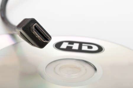 high definition: High Definition - HDMI Cable and Blank DVD Disc Stock Photo