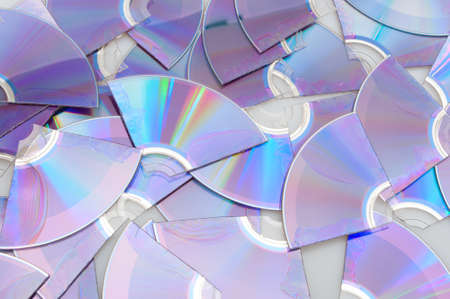 destroyed: Background of Pieces of Broken CD Compact Discs