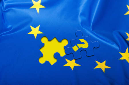overtake: Euroscepticism - Detail of Silky Flag of Blue European Union EU Flag Drapery With Puzzle Piece With Question Mark Stock Photo