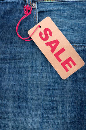Closeup of Blue Jeans With Brown Sale Tag Stock Photo - 12267742