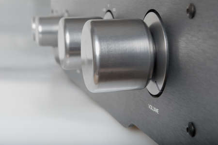 Volume Knob on Silver Metallic Amplifier - Shallow Depth of Field