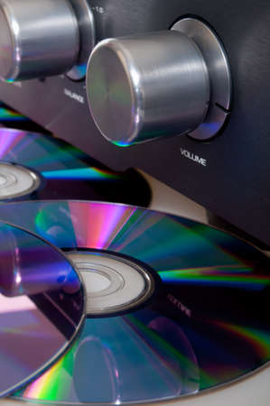 Audio - Closeup of Amplifier and CD Compact Discs photo