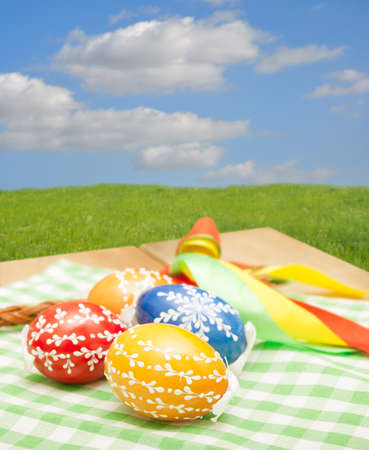 Traditional Homemade Color Painted Easter Eggs on the Table photo