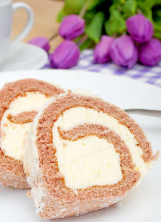 Swiss Sponge Roll With Cream on White Plate - Shallow Depth of Field photo