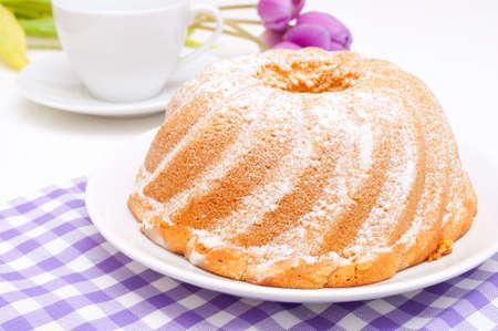 Guglhupf - Traditional Gugelhupf Sponge Cake and Tulip Flowers on Table
