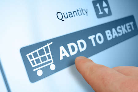 web commerce: Shopping Online - Add Finger Pushing Per Button Basket On Touchscreen Archivio Fotografico