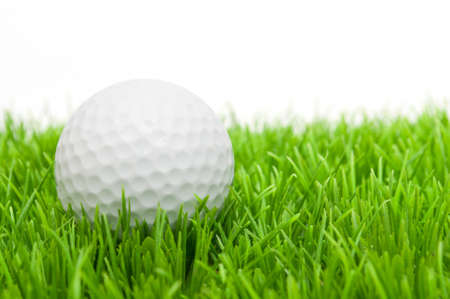 Golf Ball in Grass Isolated on White photo