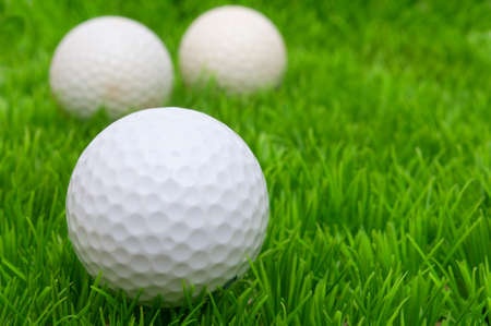 Group of Golf Balls in Green Grass