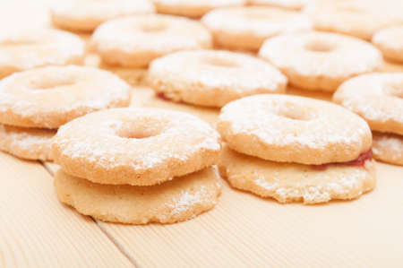 Closeup of Traditional Linzer Cookies on Wooden Board photo