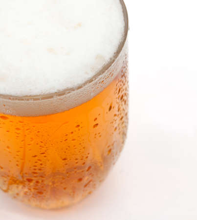 draught: Closeup of Glass of Draught Beer on White Background - Shallow Depth of Field