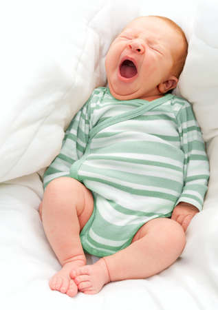 Yawning New Born Baby in the Bed