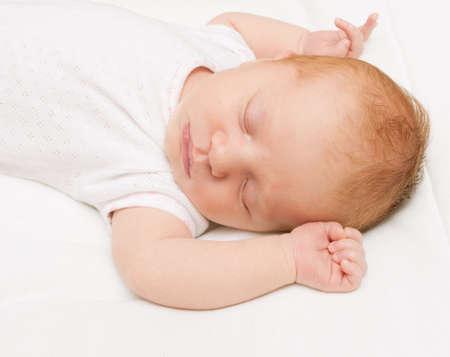 nurseling: Sleeping Newborn Baby on White Bed Sheet