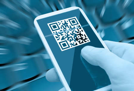 up code: Reading QR Code With Smartphone in Man Stock Photo