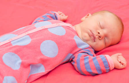 Newborn Baby Sleeping on Pink Blanket photo