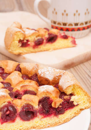 Homemade Cherry Pie and Mug on Wooden Table photo