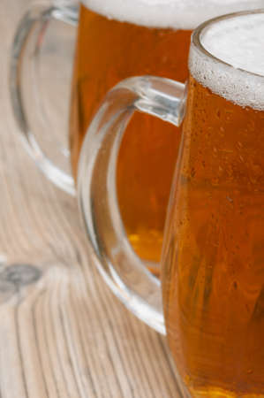 Close-up of Glasses of Beer on Old Wooden Table Stock Photo - 14380732