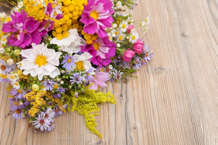 summer wooden table bouquet of wild summer flowers on wooden table vintage look
