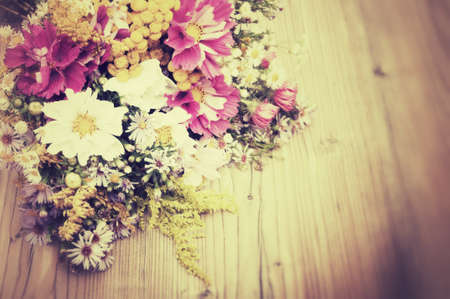 bouquet flowers: Bouquet of Wild Summer Flowers on Wooden Table - Vintage Look Stock Photo
