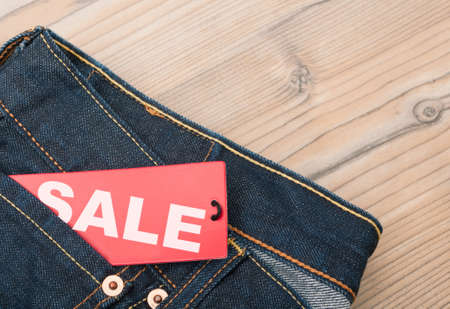 Red Sale Tag in Pocket of Blue Jeans Stock Photo - 15398759