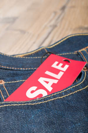 Red Sale Tag in Pocket of Blue Jeans photo