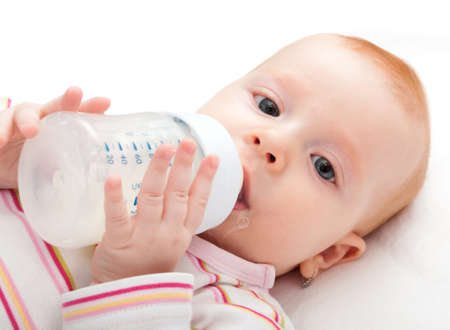 baby bottle: Closeup of Baby Girl Drinking Milk from Bottle