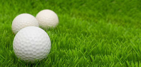 fairway: Group of Golf Balls in Green Grass