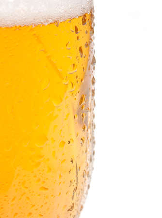 Closeup of Glass of Draught Beer on White Background  photo