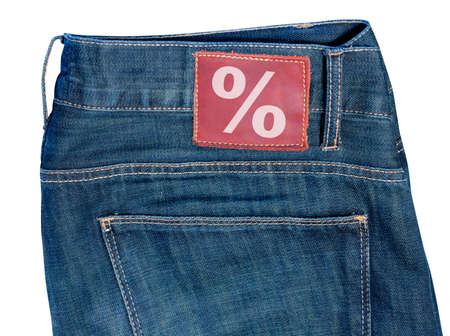 Sale - Pocket of Jeans With Percentage Symbol on Badge Stock Photo