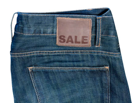 Sale - Pocket of Jeans With Sale Sign on Badge photo
