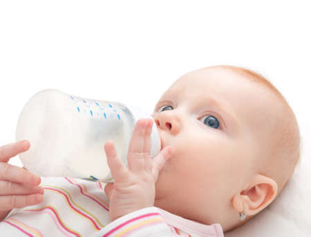 Baby Girl Drinking Milk from Bottle on White Background