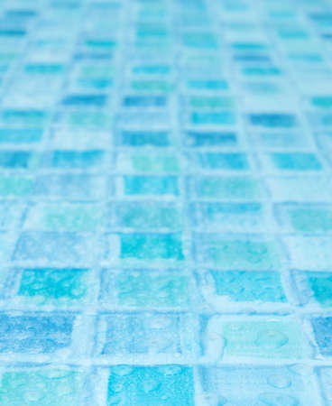 Blue Tiles in Bathroom With Water Drops - Shallow Depth of Field photo