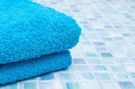 Blue Bath Towels on Blue Bathroom Tiles