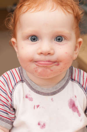 red haired girl: Portrait of Funny Baby With Dirty Face After Eating