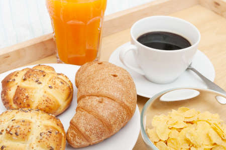 Breakfast in Bed - Corn Flakes, Coffee, Croissant, Orange Juice, Coffee and Rolls photo