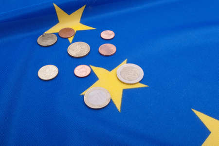 Euro Coins on Blue Flag of European Union photo