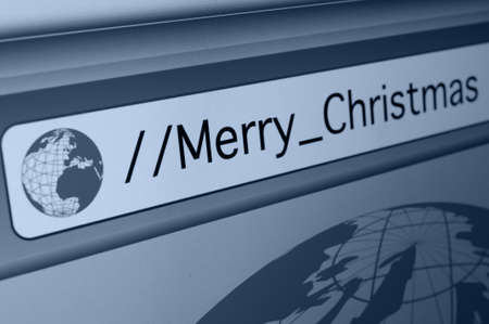 Merry Christmas Sign - Closeup of Computer Screen With Favicon and URL Address Bar in Fictitious Web Browser - Shallow Depth of Field photo
