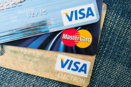 VISA and MasterCard credit cards on blue jeans Editorial